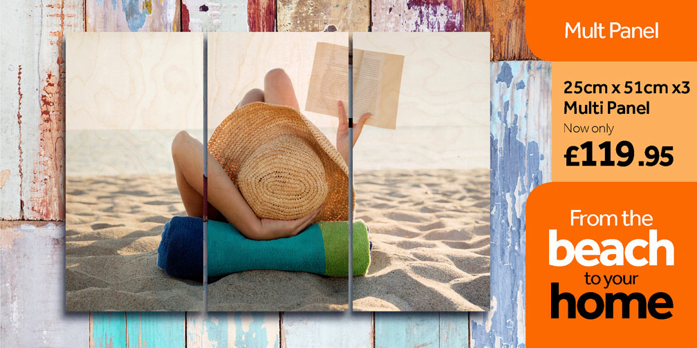 Multi panel wood print, of a woman on the beach reading